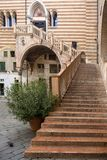 VERONA, ITALY : Ancient staircase by 15 century called Ladder of Justice in Palazzo della Ragione, center of Verona, Italy.  stock photo