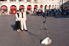 Japanese tourists in Verona, Italy, take a foto by automatic release Stock Photography