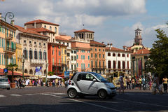 VERONA, ITALY - AUGUST 31, 2012: Small car Smart on the main square in Verona - Piazza Bra Stock Photos