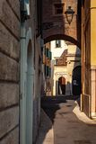 Verona, Italy – March 2019. Streets and buildings of ancient Verona city at the sunny summer day. Funny car by restourant stock photo