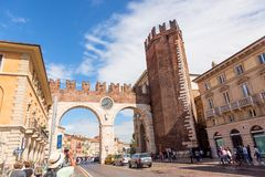 Verona, Italy - September, 2017: Medieval Porta Nuova, gate to the old town of Verona with tourists. Piazza Bra in Verona. Veneto stock photography