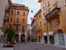 Verona, Italy - September 2, 2012: a small square of Verona with old buildings royalty free stock photography