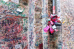 VERONA, ITALY- September 08, 2016: The wall full of messages on different foreign languages from lovers and some pink locks in Jul Stock Image