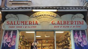Verona, Italy. Shop window of a food store with traditional Italian foods, pasta, wine, meats royalty free stock photo