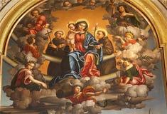 Verona - jungfruliga Mary med St.en Anthione och St Francis. Royaltyfria Bilder