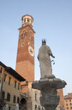 Verona, Medieval tower called Torre dei Lamberti. Verona (Veneto, Italy), Medieval tower called Torre dei Lamberti at evening viewed from Piazza Erbe royalty free stock photo