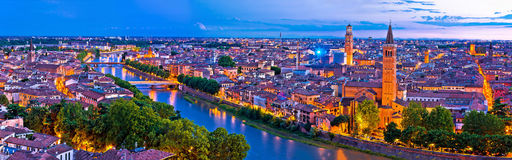 Verona old city and Adige river panoramic aerial view at evening. Veneto region of Italy Royalty Free Stock Images
