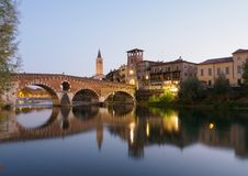 Verona and Ponte Pietra at twilight. Verona and old stone bridge in summer during twilight stock image