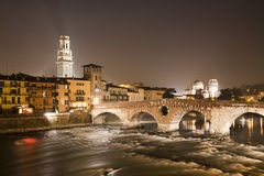 Verona -  Pietra bridge at night - Ponte Pietra and Duomo tower and San Giorgio church Royalty Free Stock Images