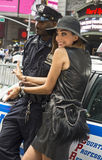 Verona Pooth. Stylish German actress/model/tv personality Verona Pooth goes through a mock arrest, complete with handcuffs from a compliant policeman in Times Stock Images