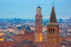 Verona skyline at night, Italy. Verona skyline with Santa Anastasia Church and Torre dei Lamberti or Lamberti Tower at night, view from Piazzale Castel San Royalty Free Stock Photo