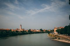 Verona. Tower overlooking a river of Verona, Italy Royalty Free Stock Images