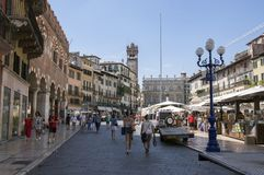 Verona town / ITALY - June 10, 2017: Verona city street during touristic summer season with groups of people. Old historic buildings around stock photos