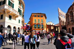 Verona town square. Part of half ruined Verona amphitheater and the town square crowded with tourists. Italy Stock Photo