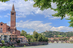 Verona. View to the old city and Etsch river, in the background the mountain with Santuario Madonna di Lourdes monument Royalty Free Stock Image