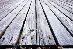 Veronachtzaamd houten dek Stock Foto's