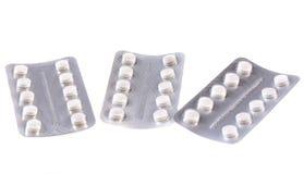 Verpackte weiße Tabletten Stockfotos