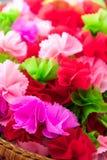 Verpackung von bunten Blumenblättern der Münzen Lizenzfreie Stockfotografie