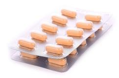 Verpackung von Tabletten auf einem weißen Hintergrund lizenzfreie stockfotografie