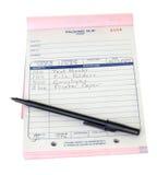 Verpackungs-Beleg-Listen-Feder-Auflage getrennter Hintergrund Stockfoto
