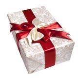 Verpakking door rood lint wordt gebonden dat Royalty-vrije Stock Foto's