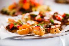 Verpflegungssnäcke, -aperitifs oder -Fingerfood Stockfotos
