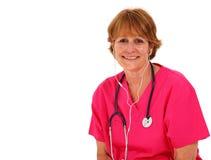 Verpleegster die aan Muziek luistert Royalty-vrije Stock Afbeeldingen