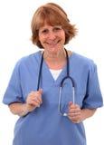 Verpleegster die bij Camera glimlacht Royalty-vrije Stock Afbeeldingen