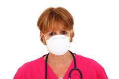 Verpleegster die Masker draagt Stock Foto's