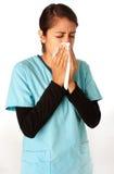 Verpleegster die in Weefsel niest Royalty-vrije Stock Foto's