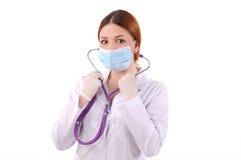 Verpleegster in een masker Stock Afbeeldingen