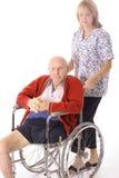 Verpleegster met bejaarde Royalty-vrije Stock Foto