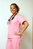 Verpleegster met Handen op Heupen Stock Foto's