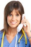 Verpleegster met telefoon stock afbeelding