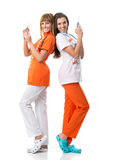 Verpleegster twee die hun ruggen elkaar draaien op Royalty-vrije Stock Foto