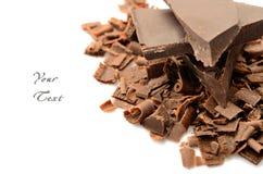 Verpletterde chocolade op witte achtergrond Royalty-vrije Stock Afbeeldingen