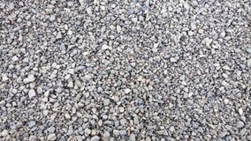Verpletterde steentextuur Kleine stenenachtergrond macadam stock foto
