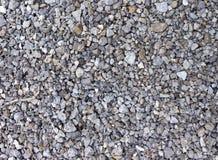 Verpletterde steentextuur Kleine stenenachtergrond macadam stock afbeelding