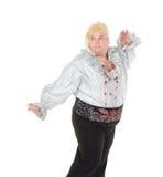 Verrückter lustiger fetter Mann, der eine blonde Perücke tragend aufwirft Lizenzfreie Stockfotografie