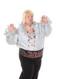 Verrückter lustiger fetter Mann, der eine blonde Perücke tragend aufwirft Stockfotos