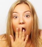 Verrast blond meisje stock foto's