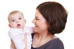 Verrast de babymeisje van de moeder holding royalty-vrije stock foto's