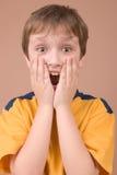 Verrast jongensportret Stock Fotografie
