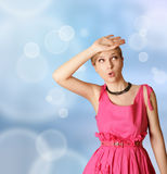 Verrast meisje in roze Royalty-vrije Stock Foto's