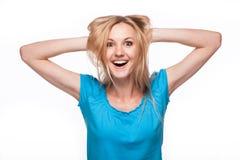 Verrast vrouwengezicht over wit Stock Afbeeldingen