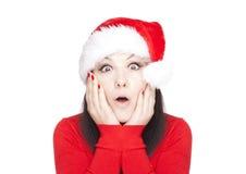 Verraste die Kerstmisvrouw over wit wordt geïsoleerdv Stock Foto's