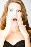 Verraste jonge vrouw Stock Afbeelding