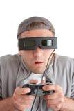 Verraste speler met bedieningshendel en 3-D glazen Royalty-vrije Stock Fotografie