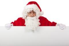 Verraste van de holdingsKerstmis van de Kerstman de advertentieraad Stock Afbeeldingen