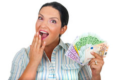 Verraste vrouw met handvol van geld stock fotografie